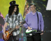 Guitarist Slash, left, plays next to Microsoft chairman Bill Gates, right, during his keynote address at the Consumer Electronics Show (CES) in Las Vegas.