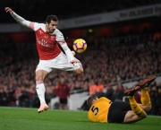 LONDON, ENGLAND - NOVEMBER 11:  Henrik Mkhitaryan of Arsenal is tackled by Ryan Bennett of Wolverhampton Wanderers during the Premier League match between Arsenal FC and Wolverhampton Wanderers at Emirates Stadium on November 11, 2018 in London, United Kingdom. (Photo by Shaun Botterill/Getty Images)